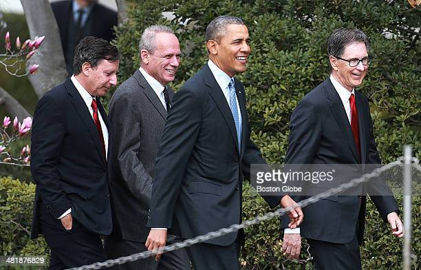 Red Sox executives Tom Werner Larry Lucchino and John Henry arrive for the ceremony with President Barack Obama who hosted the 2013 World Series...