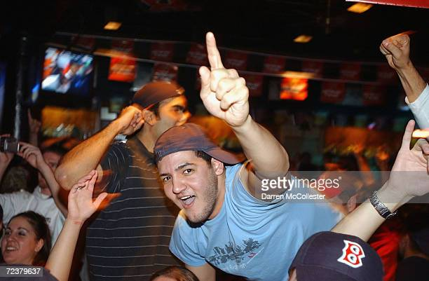 Red Sox fans celebrate a 30 Red Sox win at Who's on First bar across from Fenway Park on October 27 2004 in Boston Massachusetts The Red Sox won the...
