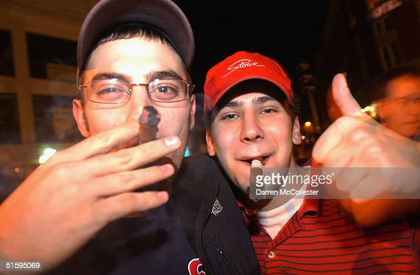 Red Sox fans smoke cigars following a 3-0 victory over the St. Louis Cardinals outside Fenway Park on October 27, 2004 in Boston, Massachusetts. The...