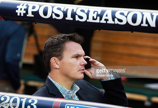 Red Sox GM Ben Cherington chats on his phone in the dugout before the game The Boston Red Sox visited the Detroit Tigers in Game Four of the American...