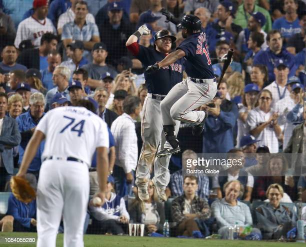 Red Sox Jackie Bradley Jr celebrates his solo home run with teammate Christian Vazquez while Dodgers pitcher Kenley Jansen reacts in the eighth...
