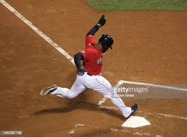 Red Sox Jackie Bradley Jr scores after a wild pitch by Astros Justin Verlander in the fifth inning Boston Red Sox hosted the Houston Astros in Game...
