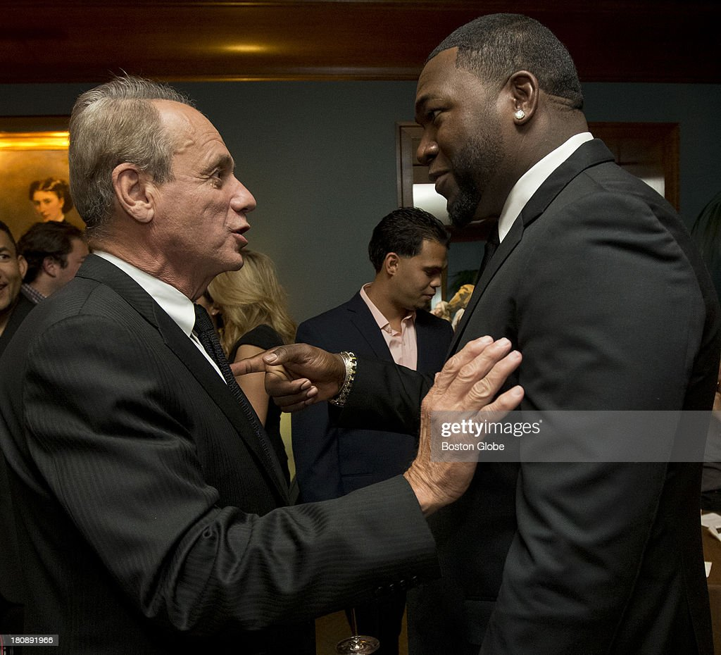 Red Sox Larry Lucchino talks to David Ortiz, who is hosting the David Ortiz Children's Fund Gala at the Four Seasons Hotel, Monday, Sept. 16, 2013.