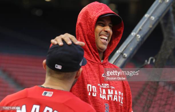 Red Sox manager Alex Cora chatted with JD Martinez before the game Boston Red Sox hosted the Houston Astros in Game Two of ALCS at Fenway Park in...