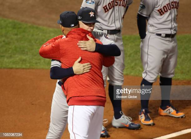 Red Sox manager Alex Cora embraced Astros manger AJ Hinch during the pregame ceremony Boston Red Sox hosted the Houston Astros in Game One of ALCS at...