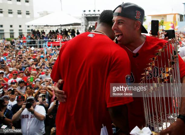 Red Sox manager Alex Cora embraces Eduardo Nunez on stage in his hometown with the World Series trophy Red Sox manager Alex Cora and some players...