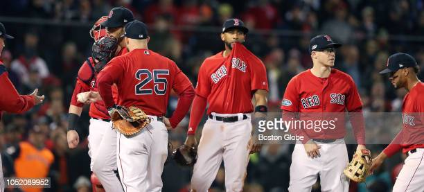 Red Sox manager Alex Cora removes relief pitcher Joe Kelly from the game after he gave up a run in the top of the sixth inning and third baseman...