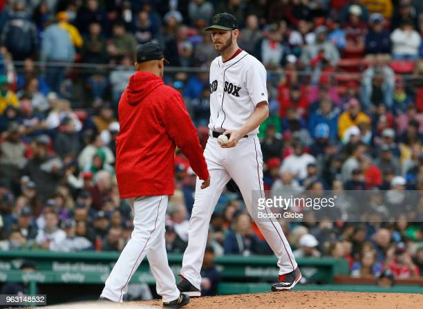 Red Sox manager Alex Cora takes starting pitcher Chris Sale out of the game during the fifth inning of a game between the Boston Red Sox and Atlanta...