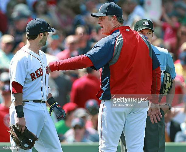 Red Sox manager John Farrell center pushes Dustin Pedroia left away after home plate umpire D J Reyburn right ejected Pedroia from the game after the...