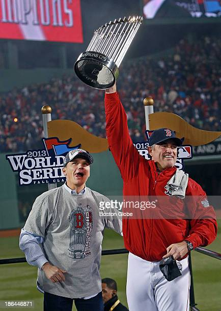 Red Sox manager John Farrell right hoists the championship trophy while general manager Ben Cherington looks on at left The Boston Red Sox host the...