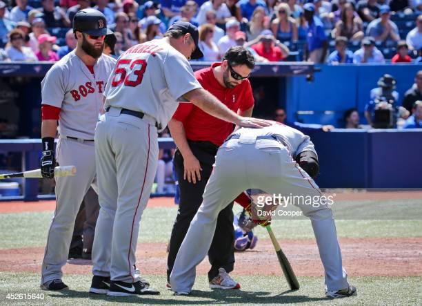 TORONTO ON JULY 24 Red Sox Manager John Farrell talks with David Ortiz after he injured himself at the plate in the top of the 9th and had to leave...