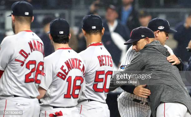 Red Sox manger Alex Cora embraced Yankees manger Aaron Boone before the game New York Yankees hosted the Boston Red Sox in game three of the ALDS at...