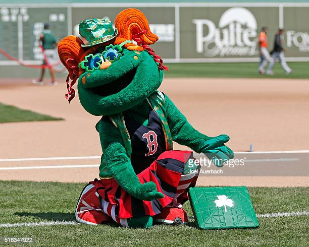 Red Sox mascot Tessie the Green Monster shows off the green bases prior to the spring training game against the Baltimore Orioles at JetBlue Park on...