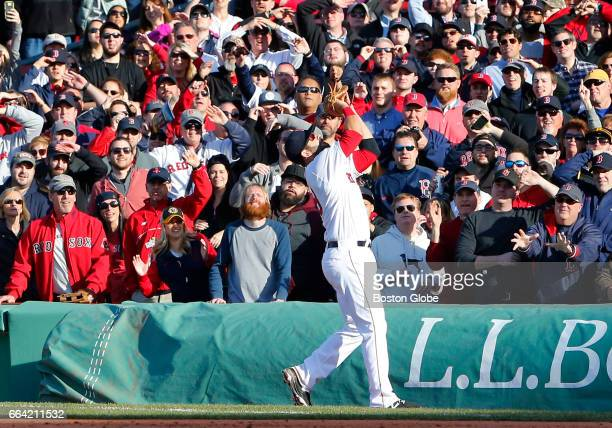Red Sox Mitch Moreland catches out Pirates' Starling Marte to end the ninth inning. The Boston Red Sox host the Pittsburgh Pirates on Opening Day at...