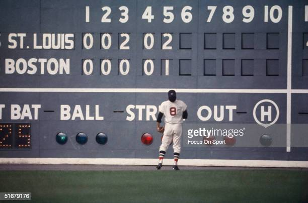 """Red Sox outfielder Carl Yastrzemski stares at the """"green monster"""", the 37' tall left field wall at Fenway Park during the 1967 World Series against..."""