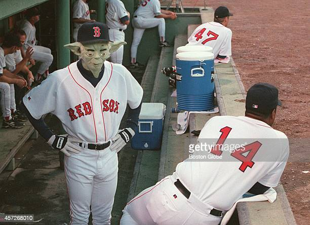 Red sox Pedro Martinez wearing injured Red sox Jim Consi's number while entertaining teammates by coming out into dugout wearing what appeared to be...