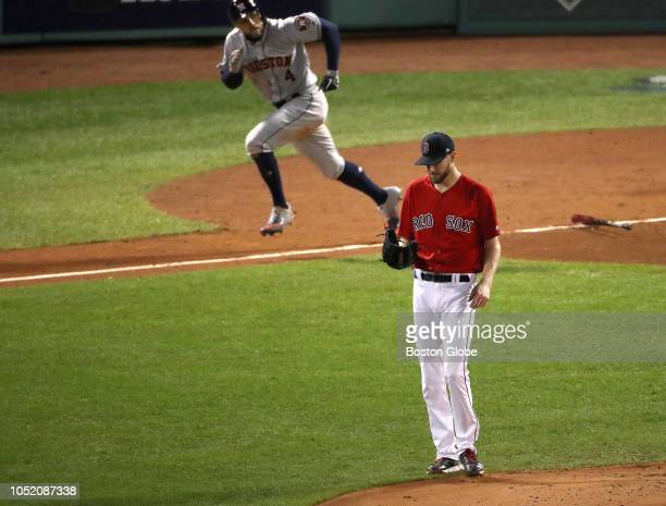 Red Sox pitcher Chris Sale reacts after Astros Alex Bregman hits a two run single in the second inning Boston Red Sox hosted the Houston Astros in...