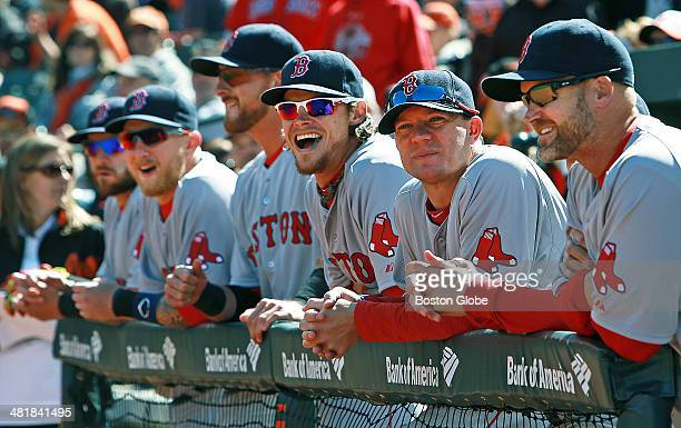Red Sox pitcher Clay Buchholz center smiles as he and some teammates watch the support staff get introduced before the player introductions The...