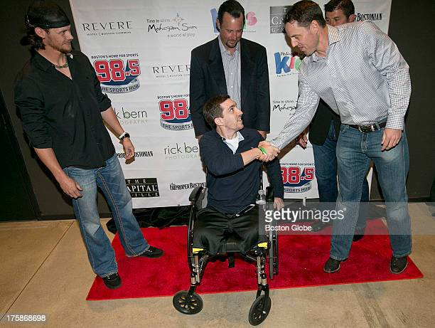 Red Sox pitcher John Lackey shook hands with Boston Marathon bombing survivor Jeff Bauman at the 2013 Pitching in for Kids Celebrity Poker Party &...