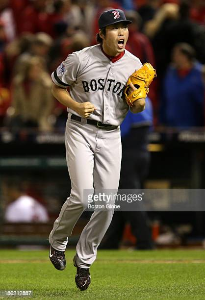 Red Sox pitcher Koji Uehara celebrates after picking Kolten Wong of the Cardinals off first base to end the game The St Louis Cardinals host the...