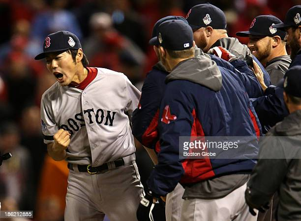 Red Sox pitcher Koji Uehara is joined by jubilant teammates after he picked Kolten Wong off first base to end the game The St Louis Cardinals host...