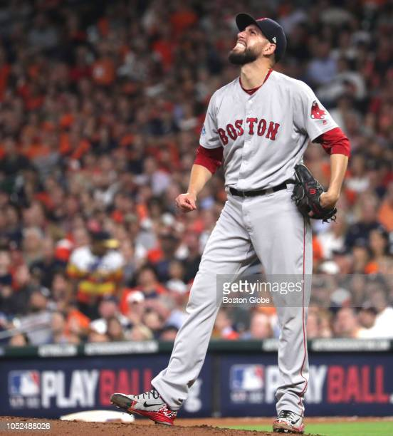 Red Sox pitcher Matt Barnes reacts after giving up a solo home run to Astros Marwin Gonzalez in the seventh inning Houston Astros hosted Boston Red...