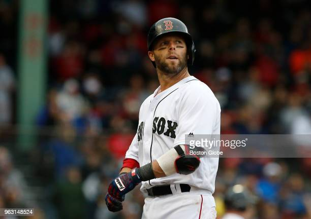 Red Sox player Dustin Pedroia looks over his shoulder after lining out to right during the fourth inning of a game between the Boston Red Sox and...