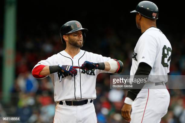 Red Sox player Dustin Pedroia reacts after flying out in the sixth inning of a game between the Boston Red Sox and Atlanta Braves at Fenway Park in...