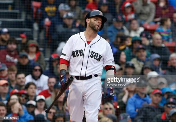 Red Sox player Dustin Pedroia reacts after striking out during the eighth inning of a game between the Boston Red Sox and Atlanta Braves at Fenway...
