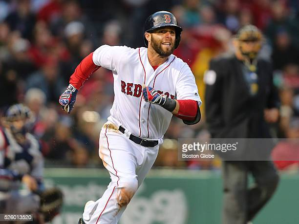 Red Sox player Dustin Pedroia runs full speed as he rounds first base on the way to second base on a first inning double hit to right field The...