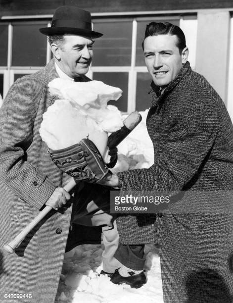 Red Sox player Jim Piersall holds a glove full of snow before leaving Logan Airport for Florida on Feb 20 1958 'It may be colder there but it's a lot...