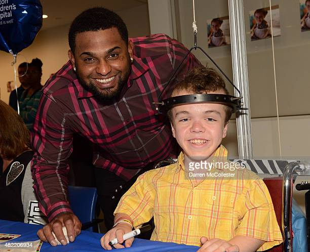 Red Sox player Pablo Sandoval takes a picture with Alexander at Boston Children's Hospital July 28 2015 in Boston Massachusetts