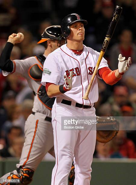 Red Sox player Ryan Sweeney strikes out in the ninth inning as the Boston Red Sox play the Baltimore Orioles at Fenway Park