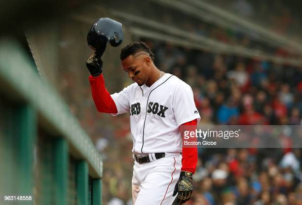 Red Sox player Xander Bogaerts reacts after flying out during the sixth inning of a game between the Boston Red Sox and Atlanta Braves at Fenway Park...
