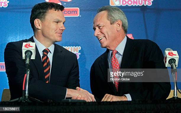 Red Sox President/CEO Larry Lucchino right shakes hands with Ben Cherington left as he introduces him as the team's new GM The Boston Red Sox held a...
