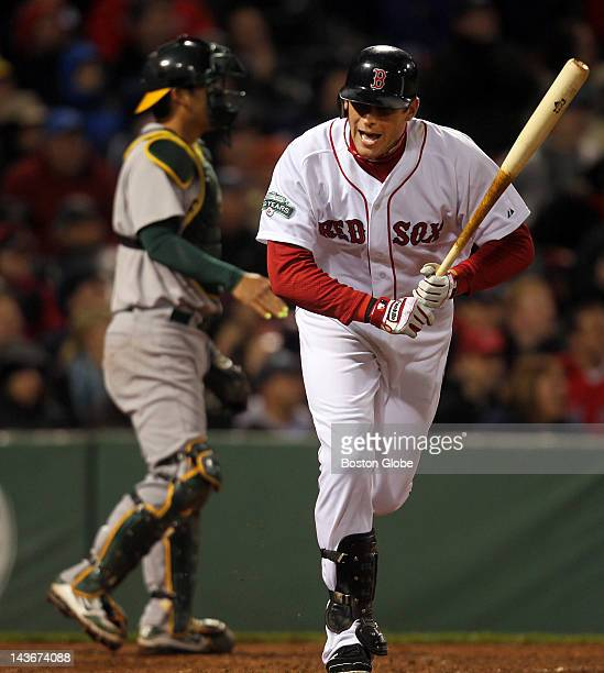 Red Sox Ryan Sweeney screams in disgust after flying out to end the fifth inning against the Oakland Athletics