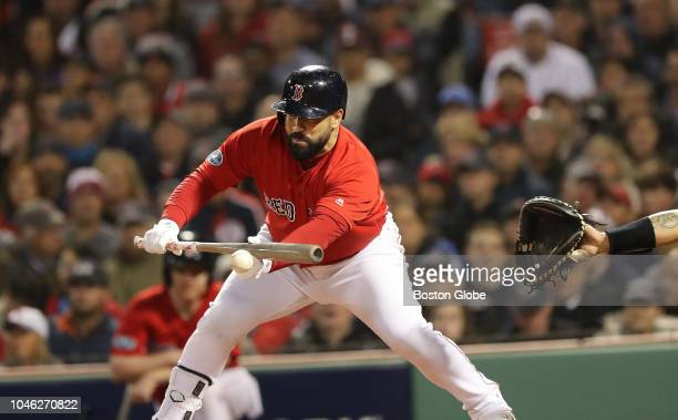 Red Sox Sandy Leon hits a sacrifice bunt in the fourth inning Boston Red Sox hosted the New York Yankees in Game 1 of the ALDS at Fenway Park in...