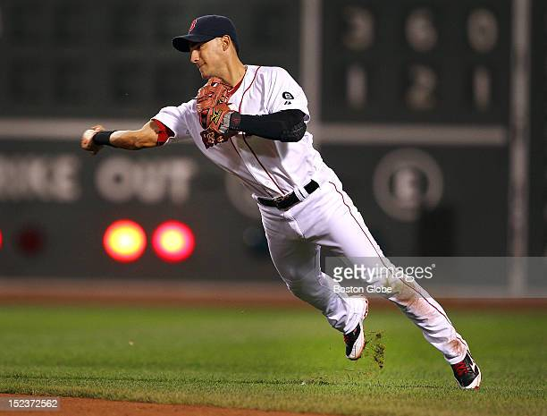 Red Sox shortstop Jose Iglesias makes a great throw to first base after diving to stop a fifth inning ball hit by the Yankees' Robinson Cano as the...