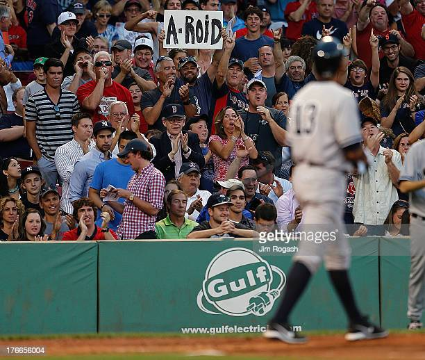Red Sox shows his feelings toward Alex Rodriguez of the New York Yankees by holding a sign after Rodriquez lined into a double play during a game...