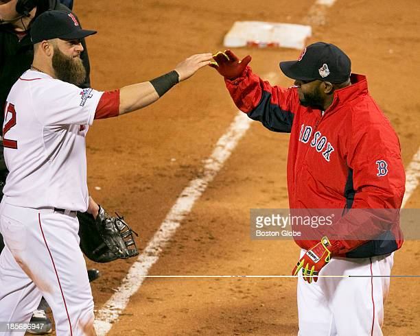 Red Sox stars Mike Napoli and David Ortiz celebrate their 81 victory over the St Louis Cardinals in Game One of the 2013 Major League Baseball World...