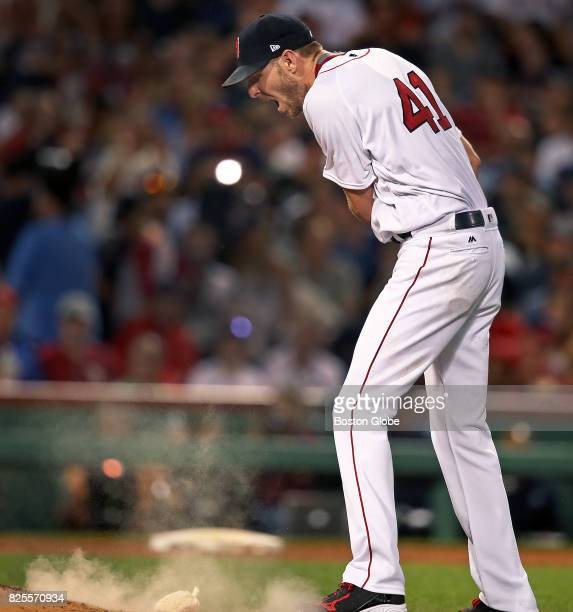 Red Sox starting pitcher Chris Sale howls as he fires the rosin bag onto the mound upset that he had just surrendered a top of the fifth inning...