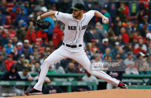 Red Sox starting pitcher Chris Sale pitches during the first inning of a game between the Boston Red Sox and Atlanta Braves at Fenway Park in Boston...