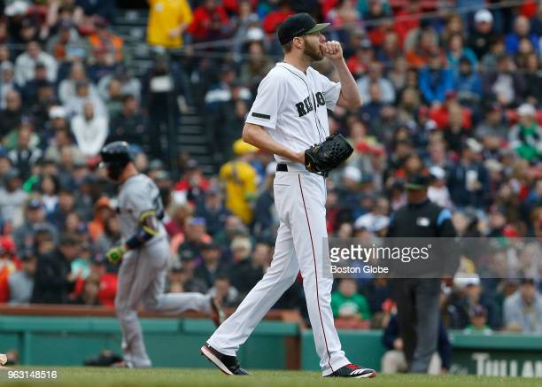 Red Sox starting pitcher Chris Sale reacts as Braves Tyler Flowers rounds the bases on his three run home run during the second inning of a game...