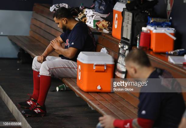 Red Sox starting pitcher Eduardo Rodriguez checks himself out in the dugout after being hit by pitch in the third inning of Game 4 of the World...
