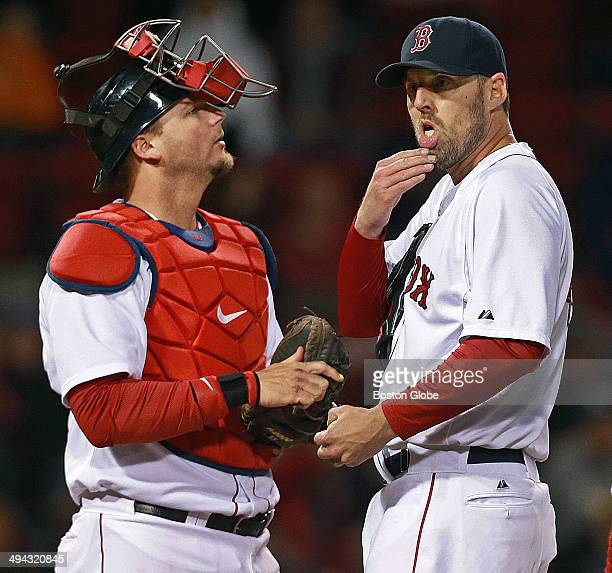 Red Sox starting pitcher John Lackey appears incredulous as he sees manager John Farrell coming towards the mound to remove him from the game in the...