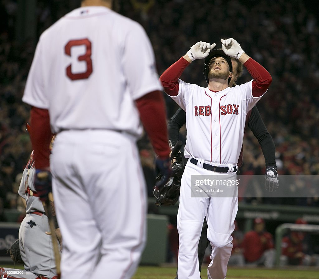 Red Sox Stephen Drew points to the sky after hitting a single home run in the third inning. The Boston Red Sox host the St. Louis Cardinals at Fenway Park for Game Six of the 2013 Major League Baseball World Series, Oct. 30, 2013.