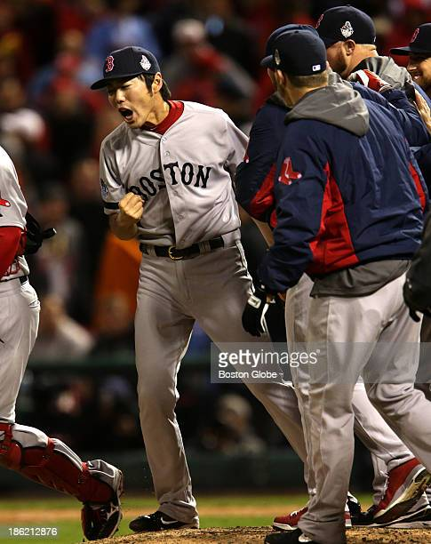 Red Sox teammates gather around pitcher Koji Uehara after he picked Cardinal Kolten Wong off first to end the game The St Louis Cardinals host the...