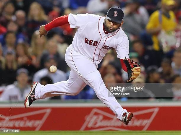 Red Sox third baseman Pablo Sandoval comes up with a grounder hit to third base hit by Orioles' Adam Jones in the fourth inning, and throws to first...