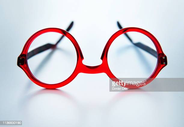 red spectacles on white surface, eyeglasses - reading glasses stock pictures, royalty-free photos & images