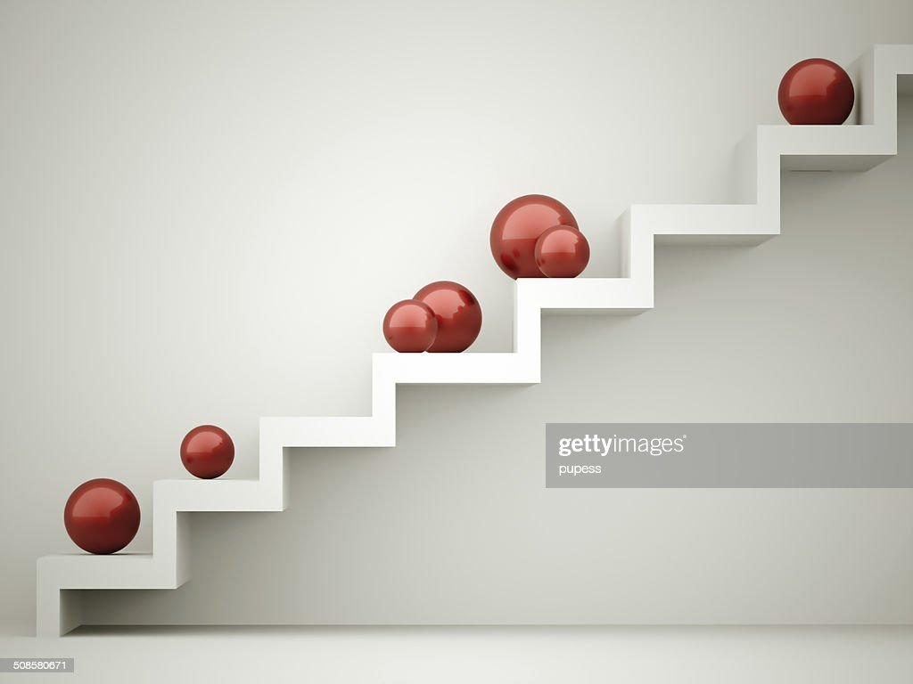 Red spheres on stairs : Stock Photo